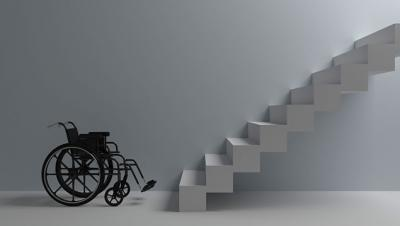 An empty wheelchair at the bottom of the stairs