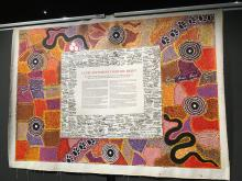 Photo of the signed and painted canvas of the Uluru Statement From the Heart